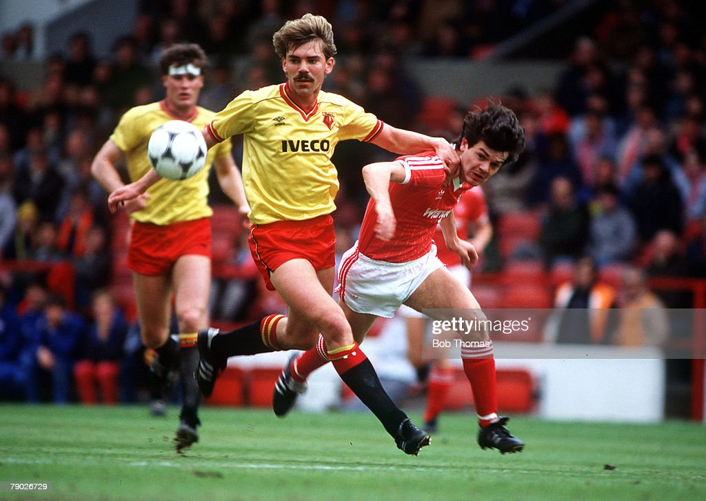 Sport. Football. League Division One. City Ground, England. 7th May 1984. Nottingham Forest 5 v Watford 1. Watford's Paul Atkinson holds off Forest's Steve Hodge. : News Photo