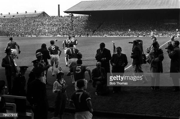Sport, Football, League Division One, Old Trafford, England, 22nd August 1964, Manchester United 2 v West Bromwich Albion 2, The players emerge from...