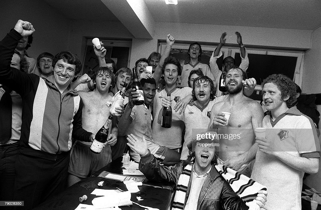 Sport. Football. League Division Three. Vicarage Road, England. 15th May 1979. Watford 4 v Hull City 0. Watford Manager Graham Taylor (left) and Chairman Elton John (front with scarf) celebrate with their players in the dressing room after achieving promo : News Photo