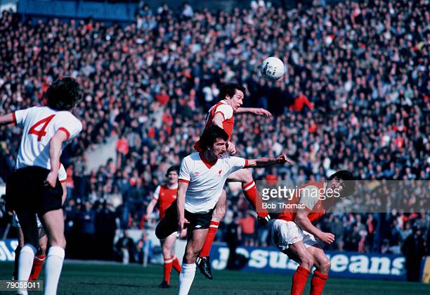 Sport Football Liam Brady and Brian Talbot of Arsenal challenge Liverpool's Graeme Souness