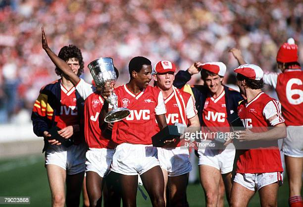 Sport Football Littlewoods Cup Final Wembley London England 5th April 1987 Arsenal 2 v Liverpool 1 Arsenal's Viv Anderson holds the trophy on the lap...