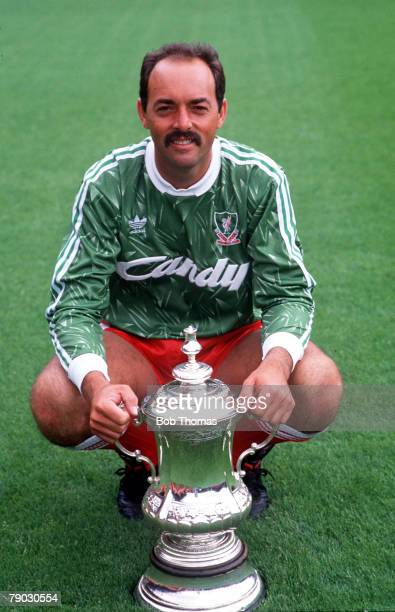 Sport Football Liverpool goalkeeper Bruce Grobbelaar is pictured with the FA Cup trophy