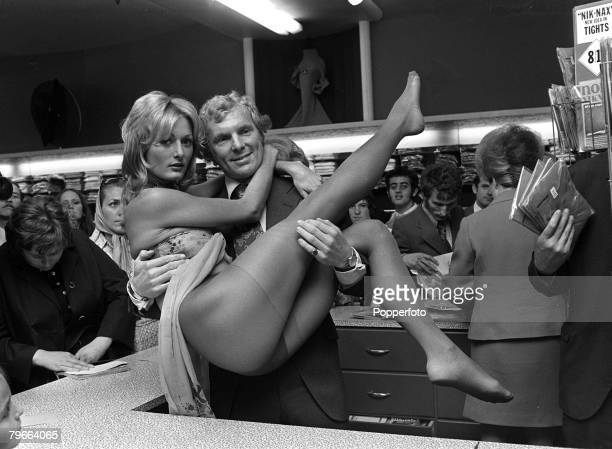Sport Football London England 10th September 1970 England captain Bobby Moore gives a model a lift in a London store to publicise new 'nude look'...