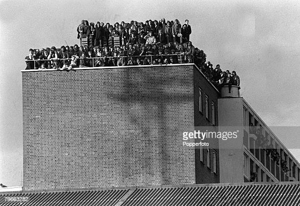 Sport Football London England 14th February 1972 Fans crowd the roof of a block of flats overlooking West Ham's Upton Park pitch as the Hammers win...