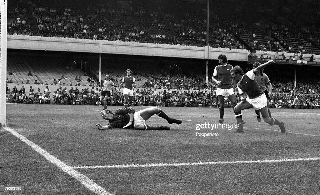 Sport, Football, London, England, 18th August 1973, FA Cup third placed play-offs, Arsenal 1 v Wolverhampton Wanderers 3, Arsenal goalkeeper Bob Wilson is left sprawling as he is watched by defenders Bob McNab (right) and Peter Simpson : News Photo