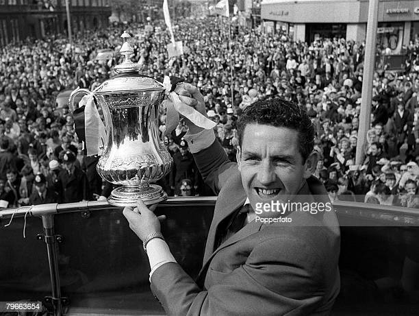 Sport Football London England 21st May 1967 Jubilant Tottenham Hotspur captain Dave Mackay displays the FA Cup trophy to a huge crowd of Spurs fans...
