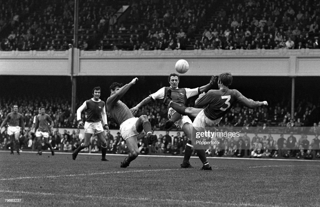 Sport, Football, London, England, 25th October 1969, League Division One, Arsenal 1 v Ipswich Town 1, Arsenal's John Radford (centre) is tackled by Ipswich's Tom Carroll (left) and Colin Harper