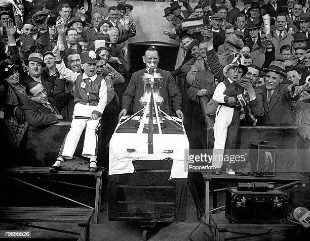 Sport Football London England 27th April 1936 Cheered by thousands of their supporters the FA Cup is paraded by Arsenal as the trophy is taken around...