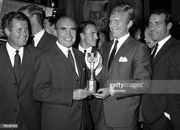 Sport Football London England 31st July 1966 England Manager Alf Ramsey holds the Jules Rimet World Cup trophy with captain Bobby Moore at a lunch...