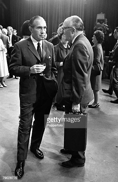 Sport Football London England 31st July 1966 England World Cup winning Manager Alf Ramsey talks to FA Secretary Denis Followes who is holding a case...