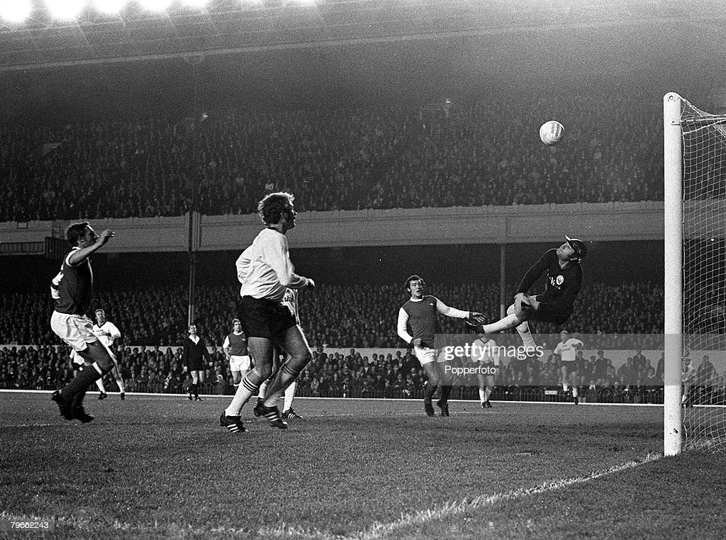 Sport, Football, London, England, 4th November 1970, Inter Cities Fairs Cup, Second Round, Second Leg, Arsenal 2 v Sturm Graz 0 (Arsenal win 2-1 on aggregate), Sturm Graz goalkeeper Grolosie saves from Arsenal's John Radford (left) : News Photo