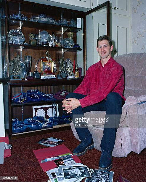 Sport Football London England April 1994 Arsenal and England defender Tony Adams at home with some of his career trophies caps medals and photographs