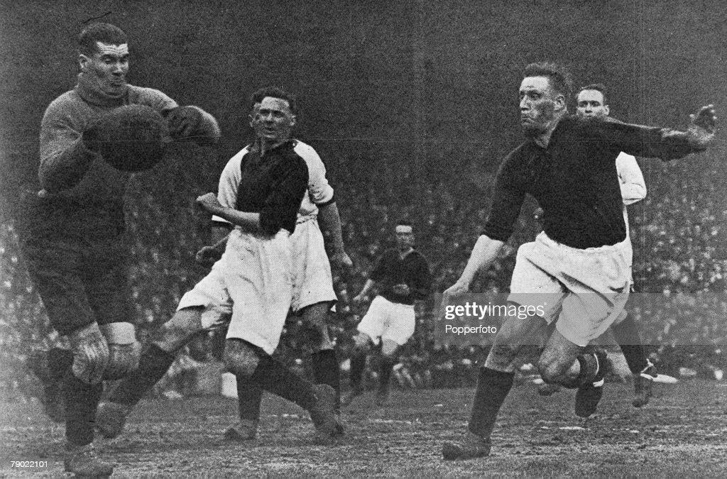Sport. Football. London, England. 1931. League Division One. Arsenal v Liverpool. Liverpool goalkeeper Elisha Scott saves from Arsenal's David Jack (left) and Jack Lambert (right). : News Photo