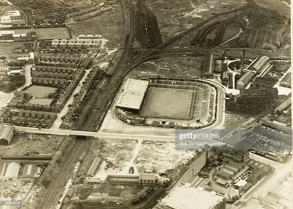 Sport. Football. Manchester, England. 1930. An aerial view of Manchester United's Old Trafford stadium, showing the surrounding houses, railway tracks and factory units. : News Photo