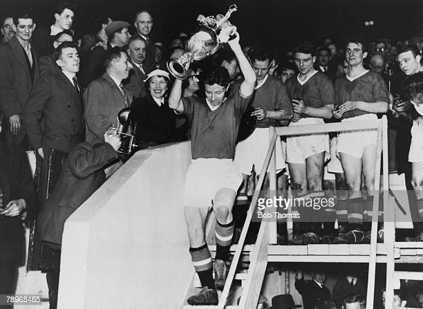 Sport Football Manchester England Manchester United captain Roger Byrne holds the First Division Championship trophy above his head after the...