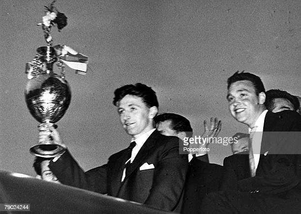 Sport Football Manchester England Manchester United captain Roger Byrne holds the First Division Championship trophy aloft during the team's tour of...