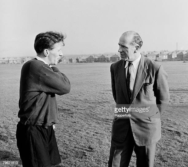 Sport Football Manchester England Manchester United coach Matt Busby talks to Roger Byrne during a training session