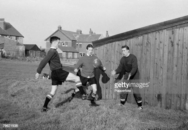 Sport Football Manchester England Manchester United players during a training session Players include Bill Whelan Dennis Viollet Ray Wood
