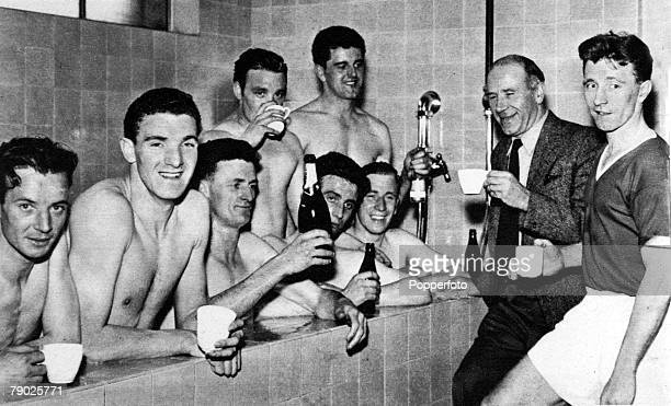 Sport Football Manchester United celebrating winning the Division One League Championship 19561957 for the second year running Players shown include...