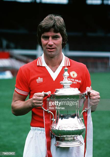 Sport Football Manchester United's Martin Buchan holds the FA Cup trophy which they won by beating Liverpool 21