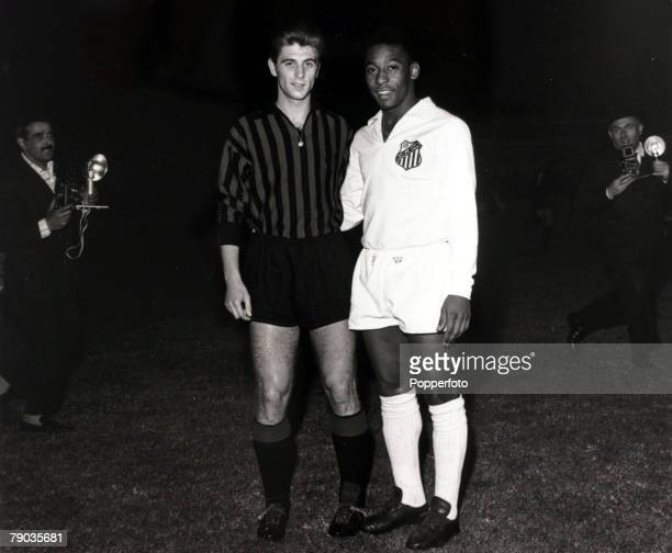 Sport Football May 1963 Santos v AC Milan AC Milan's Italian international Gianni Rivera poses with Pele of Santos before the game Pele was perhaps...