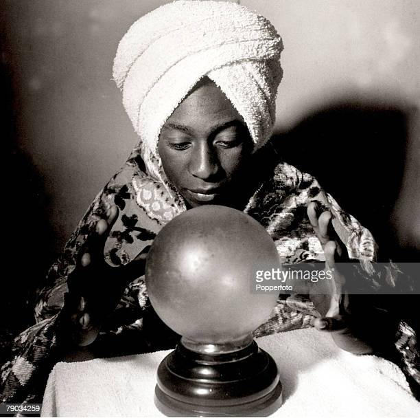 Sport Football May 1965 Brazil star Pele in an amusing picture as he studies his crystal ball Pele was perhaps the greatest player of all time he...