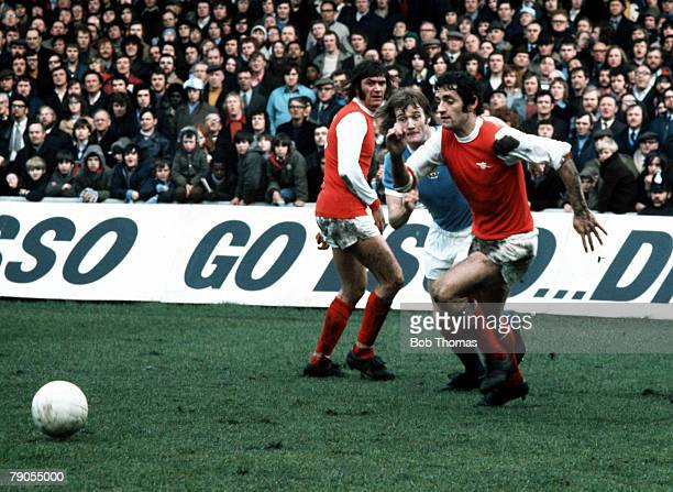 Sport Football Mclintock and Simpson of Arsenal challenge Rodney Marsh of Manchester City