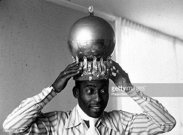 Sport Football November 1970 Brazil's Pele displays a crown presented to him after scoring his 1000th goal