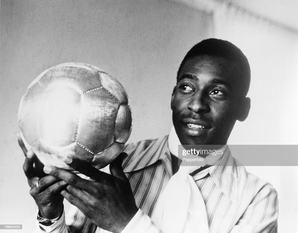 Sport, Football, November 1970, Brazil's Pele is pictured with a golden ball presented to him after scoring his 1,000th goal : News Photo