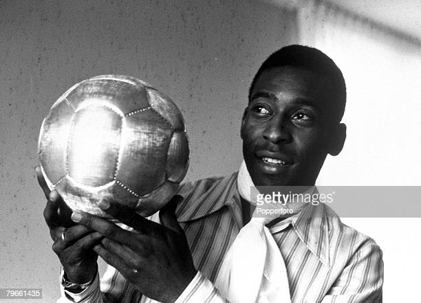 Sport Football November 1970 Brazil's Pele is pictured with a golden ball presented to him after scoring his 1000th goal