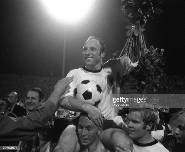 Sport, Football, Nuremberg, West Germany, 9th September 1970, West German captain Uwe Seeler is chaired by teammates after he played his last...