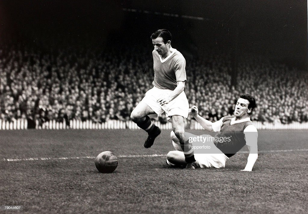 Sport. Football. Old Trafford, England. 26th September 1957. League Division One. Manchester United v Arsenal. Manchester United winger Johnny Berry leaves an Arsenal defender in his wake as he races away. : News Photo