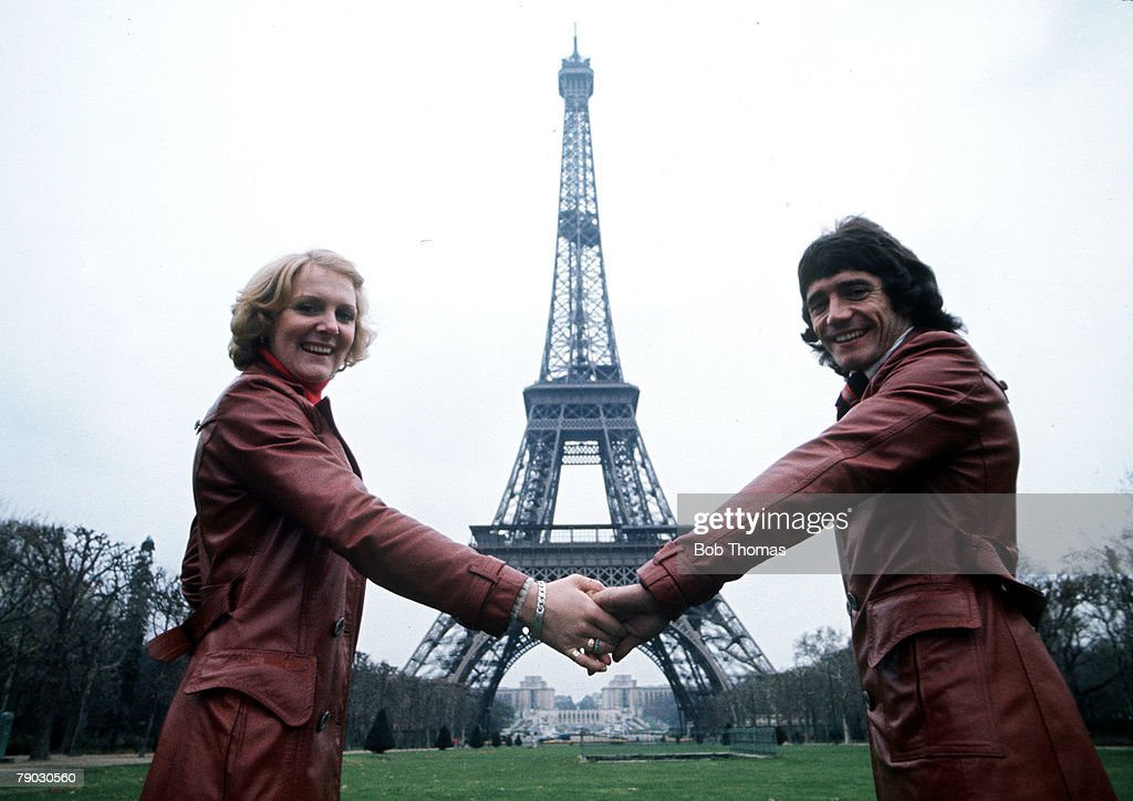 Sport. Football. Paris, France. November 1976. Liverpool and England's Kevin Keegan is pictured with his wife Jean during a holiday in Paris, seen here hand-in-hand in front of the Eiffel Tower. : News Photo
