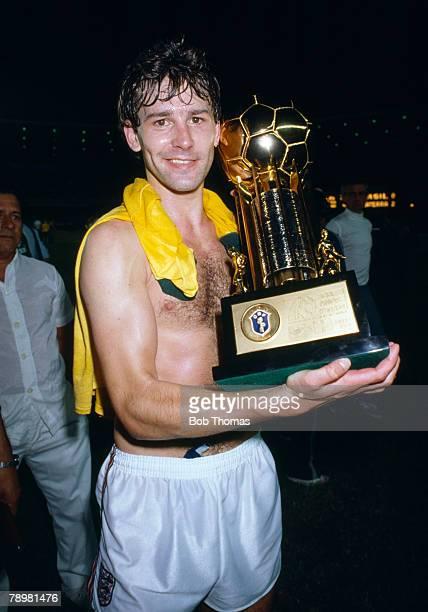 10th June 1984, England Tour of South America, Brazil 0 v England 2 in Rio de Janeiro, England captain Bryan Robson with the trophy England received...