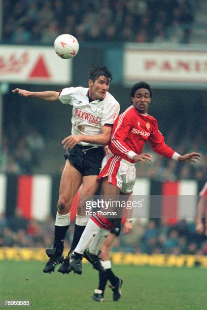 10th November 1990, Division 1, Derby County 0 v Manchester United 0, Manchester United's Paul Ince, right, jumps for a high ball with Derby County's...