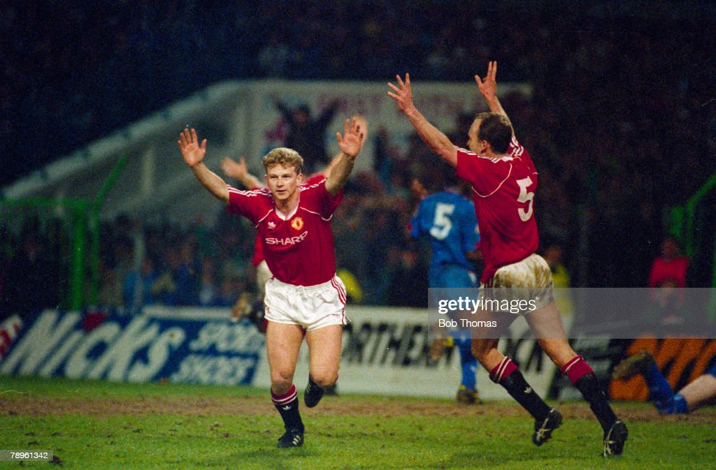 Sport. Football. pic: 11th April 1990. FA. Cup Semi-Final at Maine Road. Manchester United 2 v Oldham Athletic 1 a.e.t. Manchester United striker Mark Robins celebrates his match-winning goal with no5 Mike Phelan. : News Photo