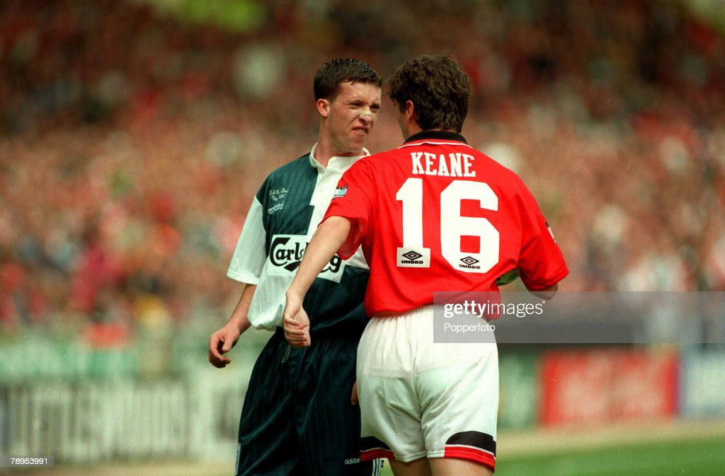 Sport. Football. pic: 11th May 1996. FA. Cup Final at Wembley. Liverpool 0. v Manchester United 1. Liverpool's Robbie Fowler in an angry exchange with Manchester United's Roy Keane. : News Photo