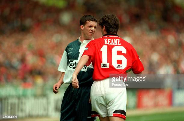 11th May 1996 FA Cup Final at Wembley Liverpool 0 v Manchester United 1 Liverpool's Robbie Fowler in an angry exchange with Manchester United's Roy...