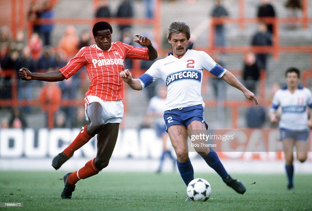 Sport. Football. pic: 11th October 1981. Nottingham Forest's Justin Fashanu rushes in to challenge Vancouver Whitecap's Jimmy Holmes. : News Photo
