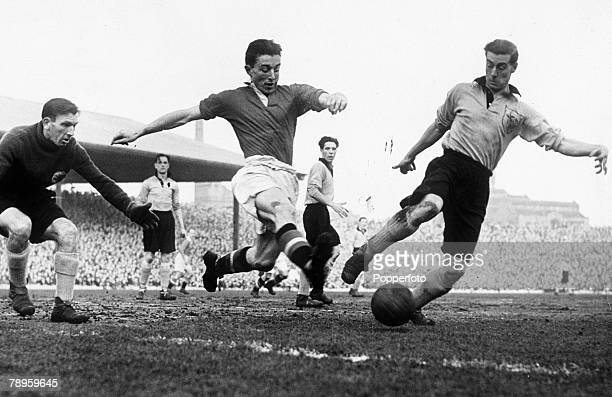 12th January 1952 Division 1 Manchester United 0 v Hull City 2 Manchester United's John Downie centre stretches for the ball as Hull City's Hassall...