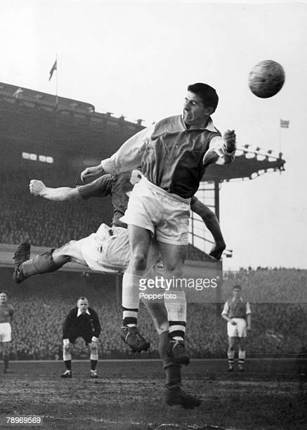 12th January 1957 Division 1 Arsenal v Portsmouth at Highbury Arsenal's Joe Haverty jumps above as referee Mervyn Griffiths looks on