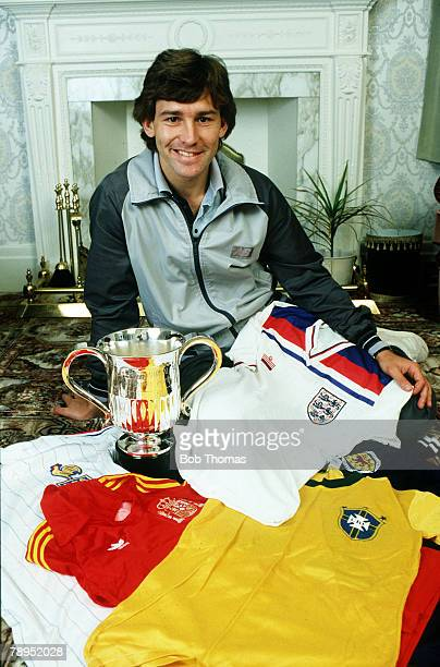 12th September 1983 Manchester United and England captain Bryan Robson with some of his collection of international shirts and the Bill Shankly Sun...