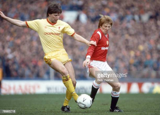 13th April 1985 FA Cup SemiFinal at Goodison Park Manchester United 2 v Liverpool 2 aet Liverpool's Ronnie Whelan is challenged by Manchester...