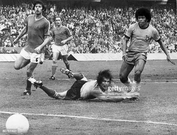 13th June 1974 1974 World Cup Finals in Germany Frankfurt Group Match Brazil 0 v Yugoslavia 0 Brazil's Jairzinho right slips the ball Yugoslavia...