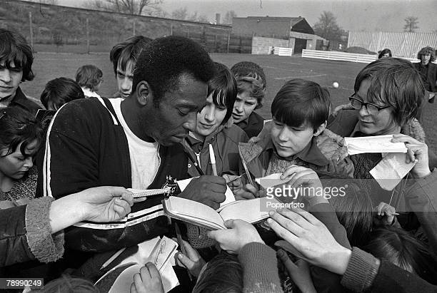 13th March 1973 Brazilian star Pele signs autographs for fans prior to playing for Santos of Brazil against Fulham in a friendly match at Craven...