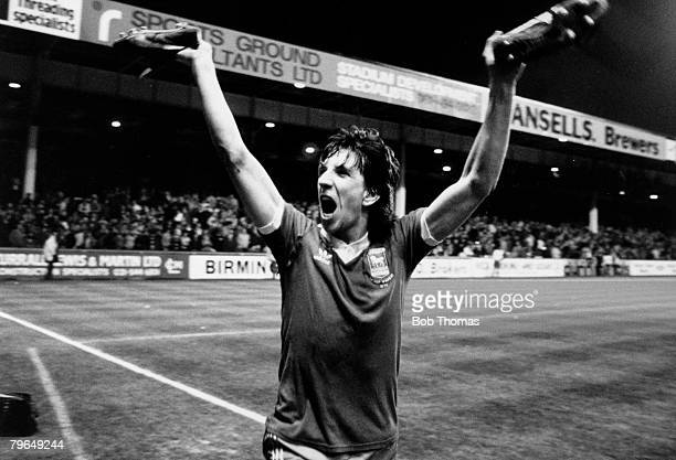 14th April 1981, Aston Villa 1 v Ipswich Town 2, Ipswich Town striker Paul Mariner holds his boots in the air as he celebrates at the end of the match