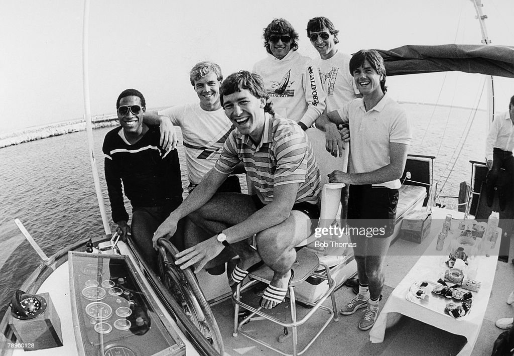 """BT Sport. Football. pic: 14th June 1985. England Summer Tour in Los Angeles. England captain Bryan Robson skippers """"The Future"""" at the Marina Del Reye watched by his crew John Barnes, Kerry Dixon, Glenn Hoddle, Dave Watson and Terry Fenwick. : News Photo"""