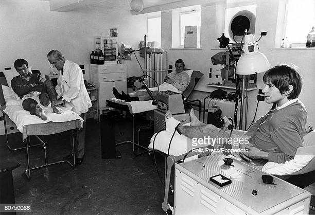 14th October 1968 Manchester United phsiotherapist Ted Dalton at work in the Old Trafford treatment room with David Sadler as Bobby Noble and John...