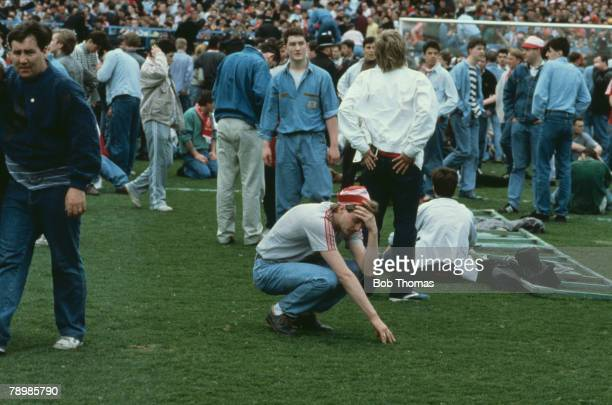 15th April 1989 FA Cup SemiFinal at Hillsborough Liverpool 0v Nottingham Forest 0 Match Abandoned A Liverpool fan in tears after escaping the crush