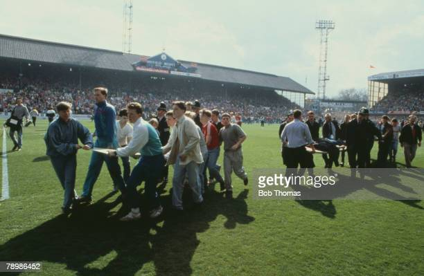15th April 1989 FA Cup SemiFinal at Hillsborough Liverpool 0v Nottingham Forest 0 Match Abandoned Injured fans are carried on advertising boards used...